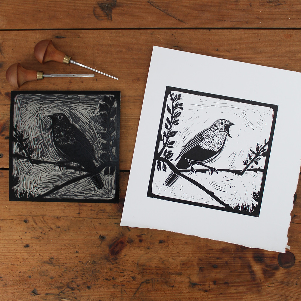 Finished print and linocut block for the Sutton Hoo nightingale bird illustration.