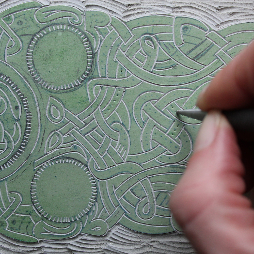 Creating the punched circles for linocut illustration of the Sutton Hoo Anglo-Saxon gold belt buckle.
