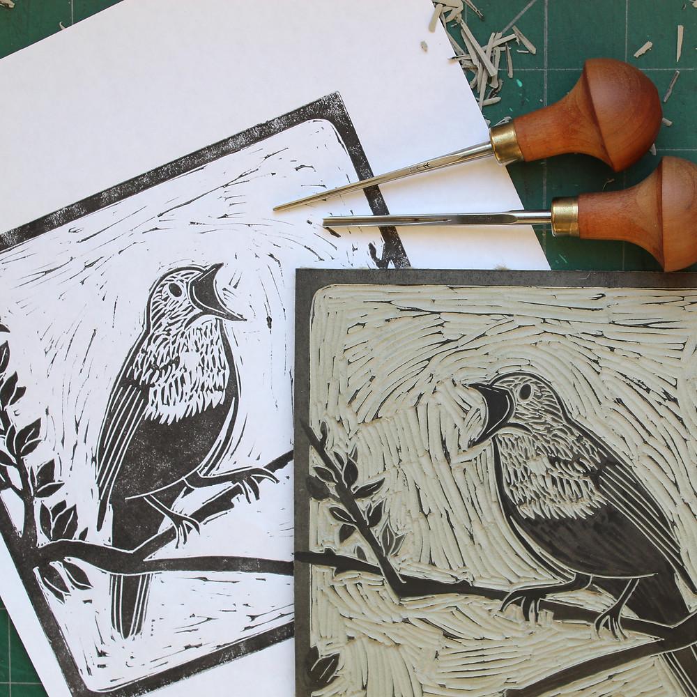 Test printing the Sutton Hoo nightingale bird linocut illustration