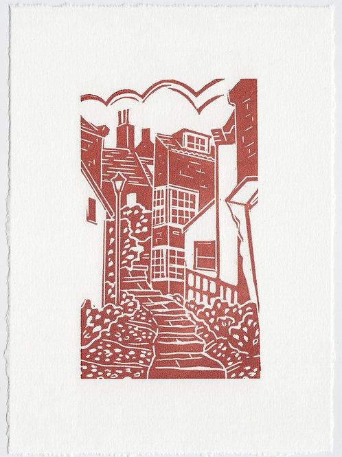 Yorkshire Coast linocut print, cobbled streets - terracotta