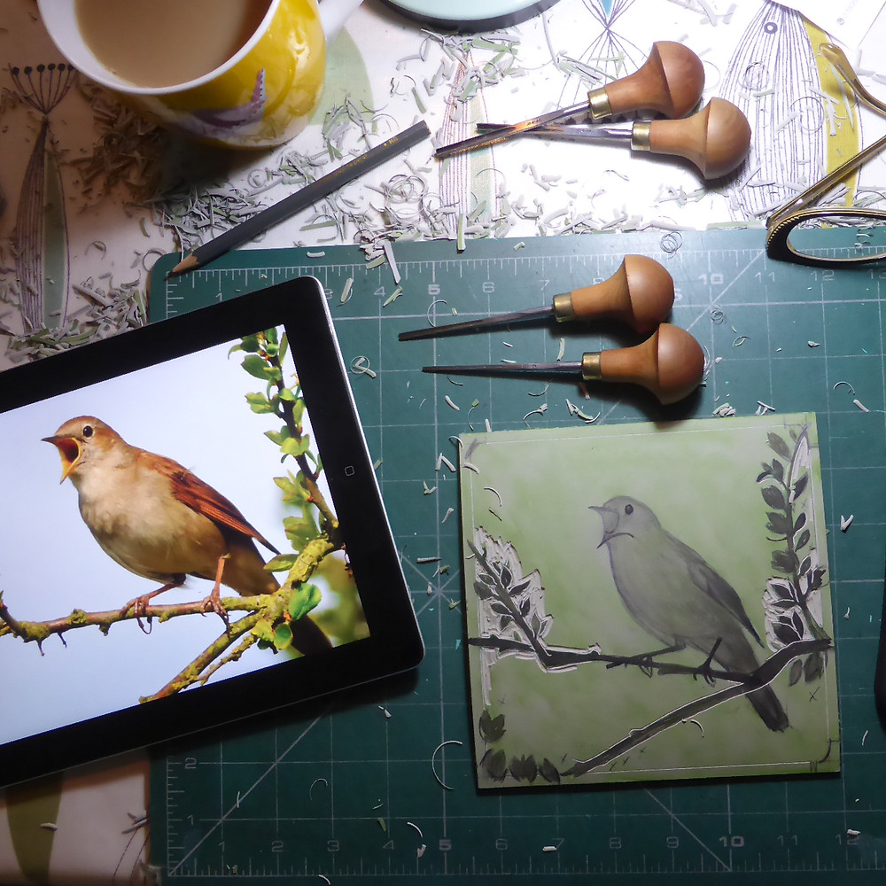 Photographic reference and lino block for Sutton Hoo nightingale bird illustration