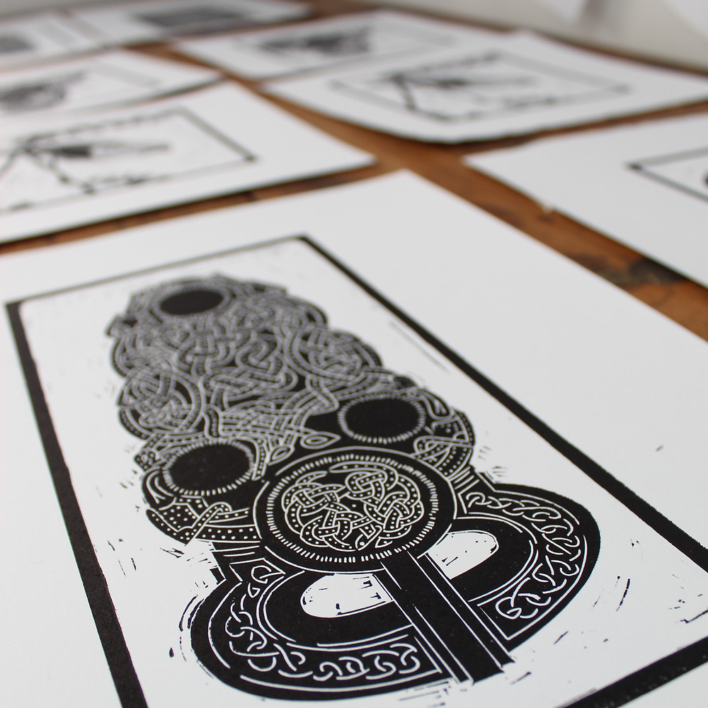 Printed linocut illustration of the Sutton Hoo Anglo-Saxon gold belt buckle.