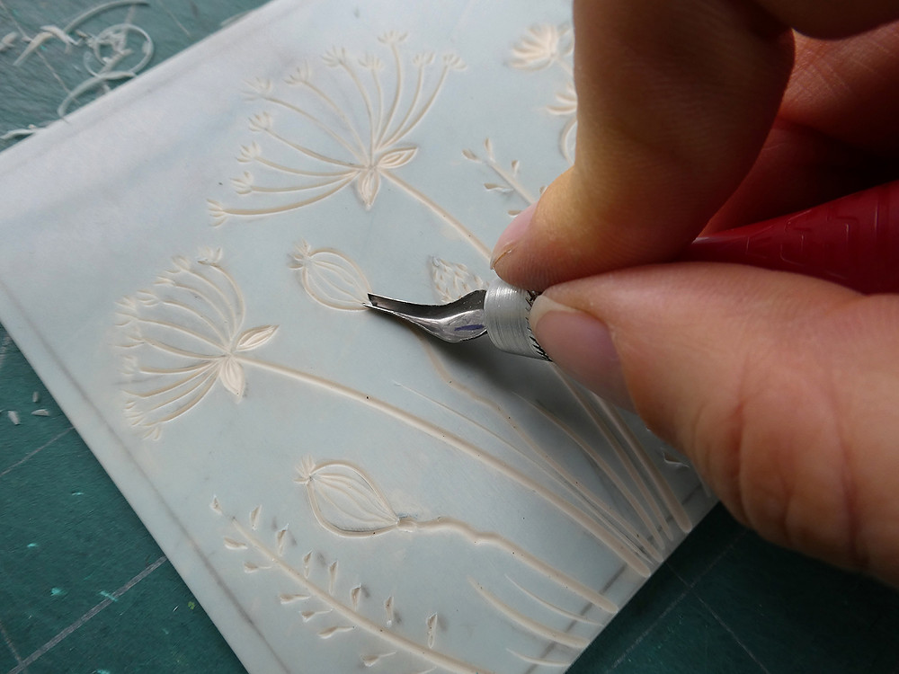 Carving soft cut lino with beginners linocut tools