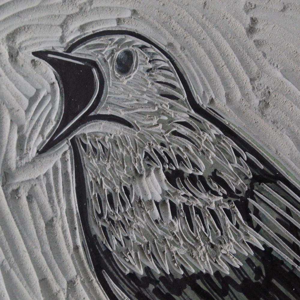 Carving the Sutton Hoo nightingale bird linocut illustration