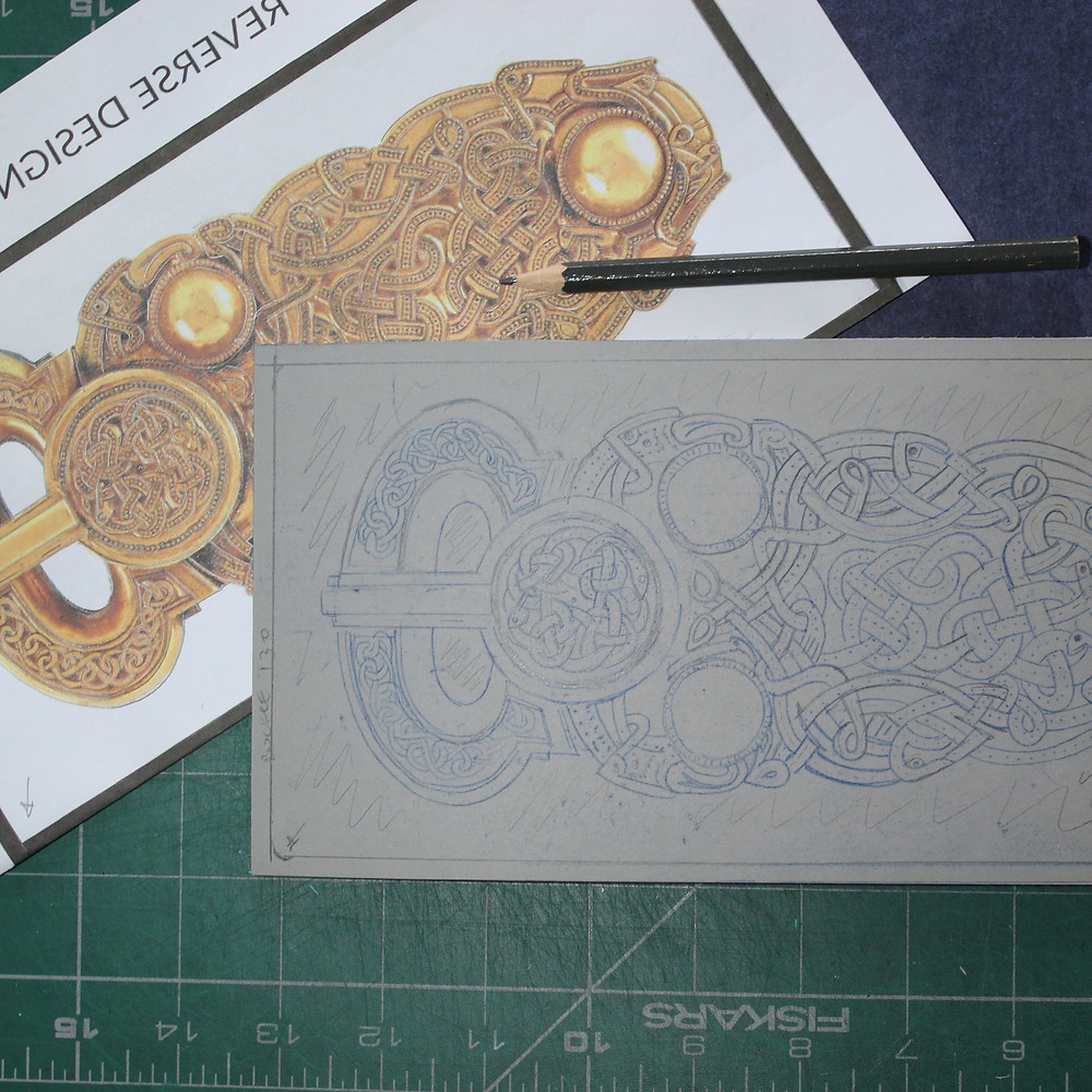 Transferring the design of the Sutton Hoo gold belt buckle onto the lino block.