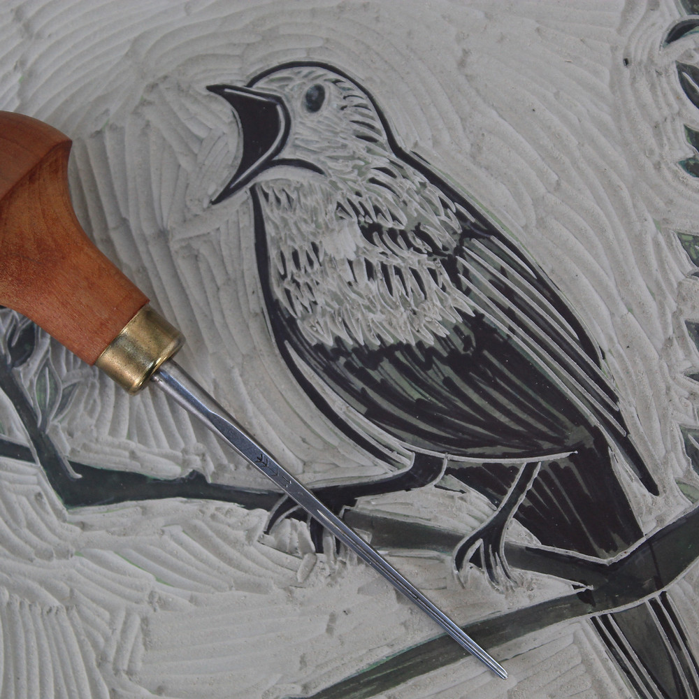 Linocutting the nightingale bird linocut illustration for National Trust's place, Sutton Hoo