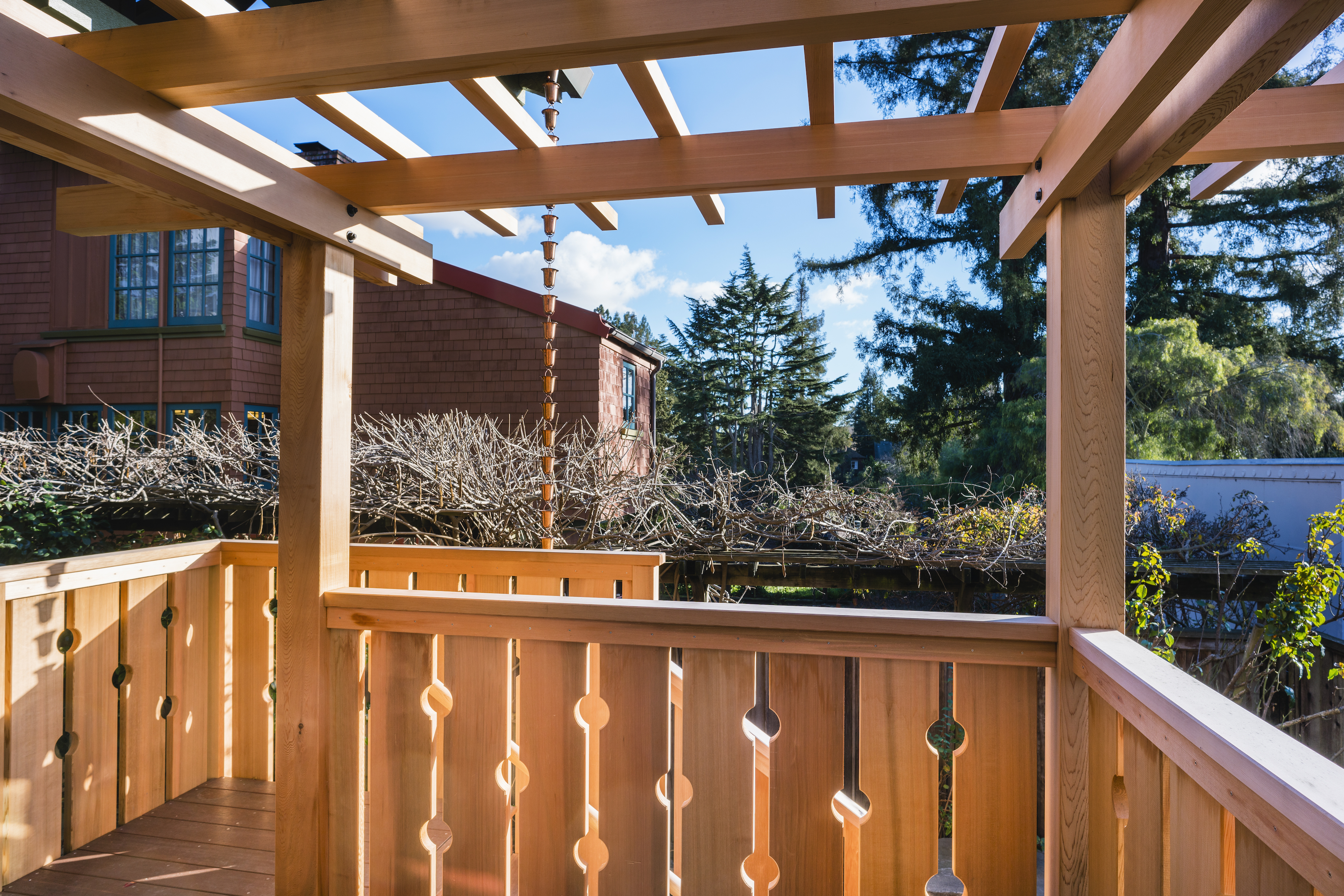 Deck with pergola and rain chain.