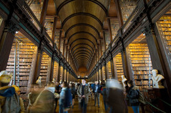 Read a book in Trinity College library
