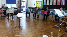 Attentive 9 year olds meet our instruments and join in with a range of musical pieces.