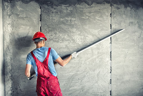 industrial-worker-with-plastering-tools-