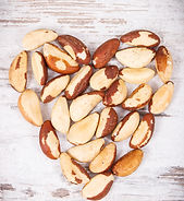 heap-of-brazil-nuts-in-shape-of-heart-he