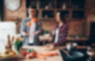 husband-juggles-oranges-while-wife-cooki