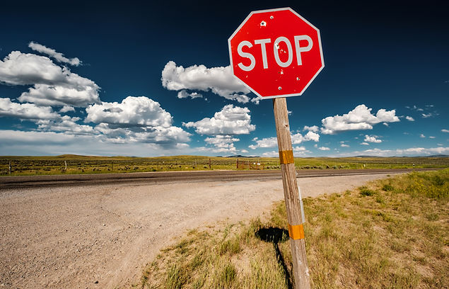 stop-sign-on-empty-highway-in-wyoming-PU
