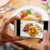 hands-with-smartphone-picturing-food-at-