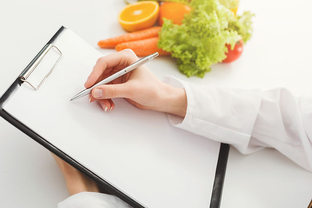 nutritionist-doctor-writing-diet-plan-on