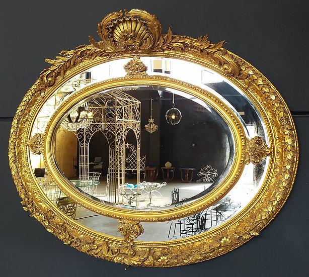 Enorme specchiera ovale dorata - Italia XX sec.