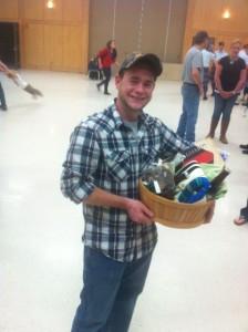 Brenden Kelly wins the raffle basket.