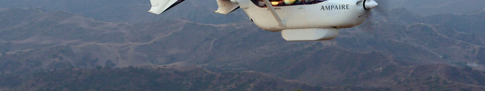 Electric EEL Aircraft in flight: side view with Camarillo, CA sky and mountains in background