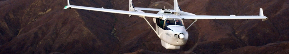 Electric EEL Aircraft in flight: front view with California mountain landscape in background