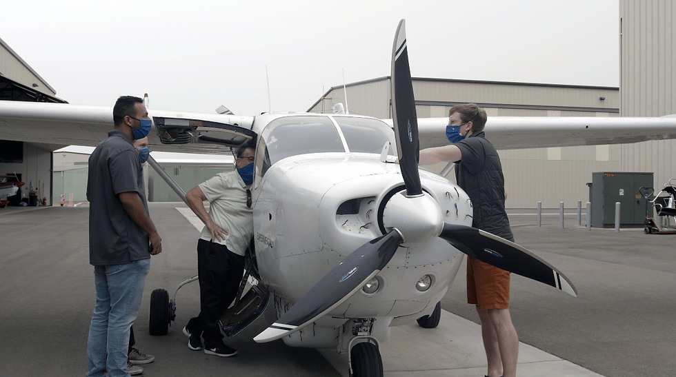 Engineers standing around the Ampaire Electric EEL aircraft on the tarmac after the latest model's first flight