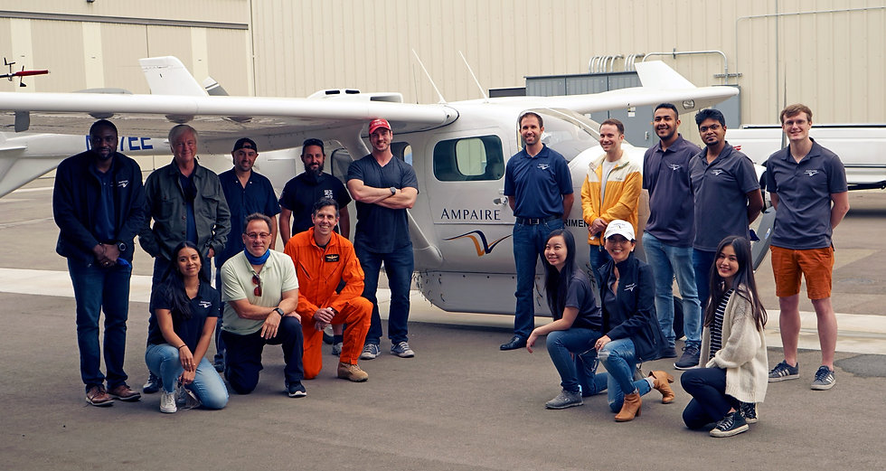 Group photo of the Ampaire team posing in front of the latest model of the Electric EEL Aircraft in Camarillo, CA
