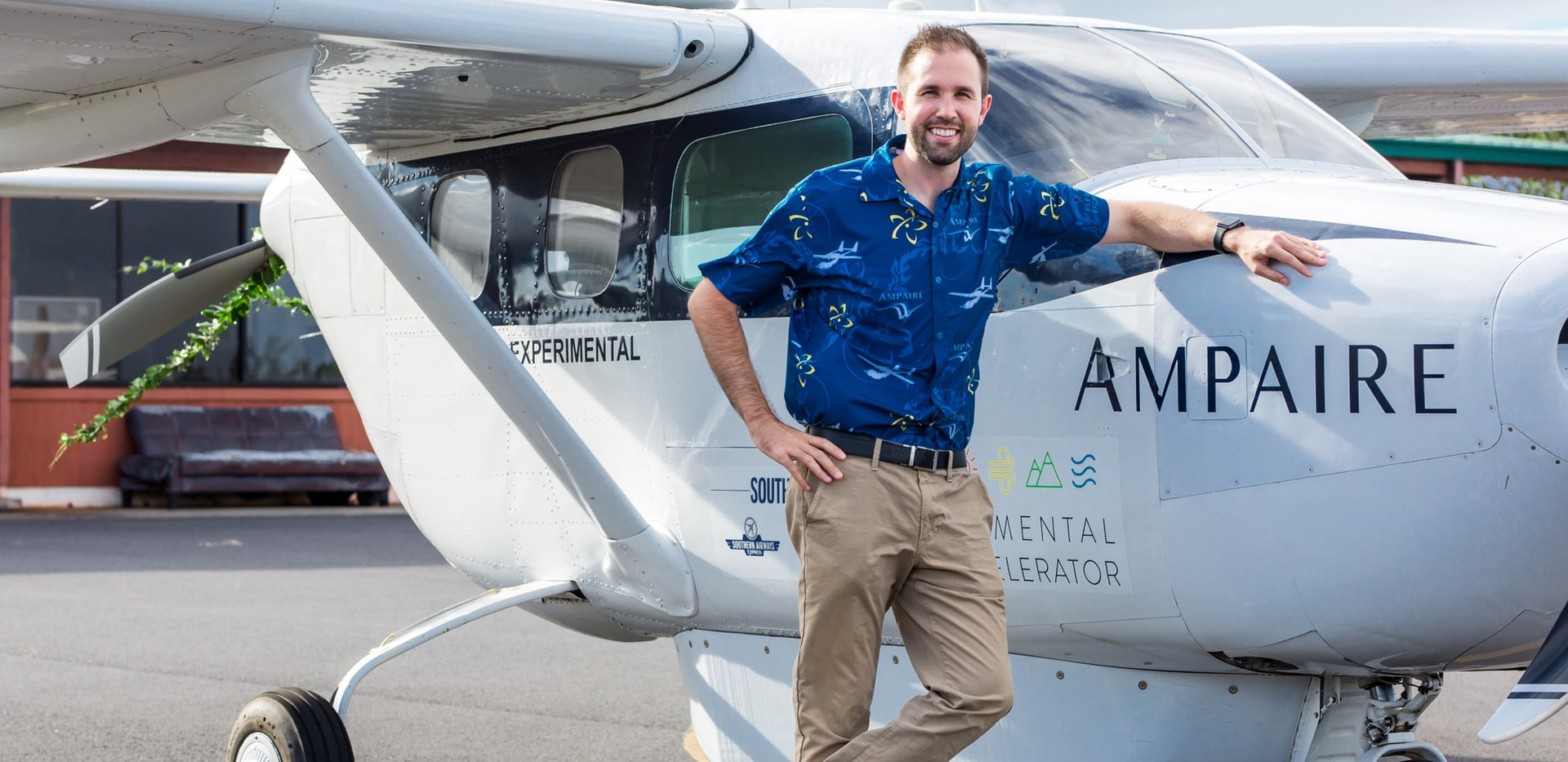 Ampaire CEO Kevin Noertker stands beside the Electric EEL on the tarmac