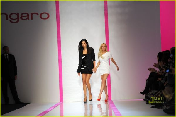 PARIS, FRANCE - OCTOBER 04:  Lindsay Lohan (R) and Estrella Archs walk the runway during the Emmanuel Ungaro Pret a Porter show as part of the Paris Womenswear Fashion Week Spring/Summer 2010 at Le Carrousel du Louvre on October 4, 2009 in Paris, France.  (Photo by Pascal Le Segretain/Getty Images)