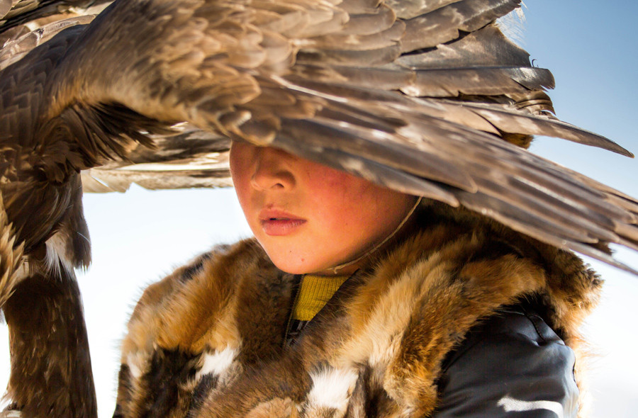 A young Kazakh boy with his eagle which will perform at the traditional Eagle Festival held in Bayan-Ölgii, Mongolia. Eagle hunting is a heritage passed from father to son, generation after generation, by the Kazakh people of the Altai mountains.  © Massimo Rumi / National Geographic Travel Photographer of the Year Contest
