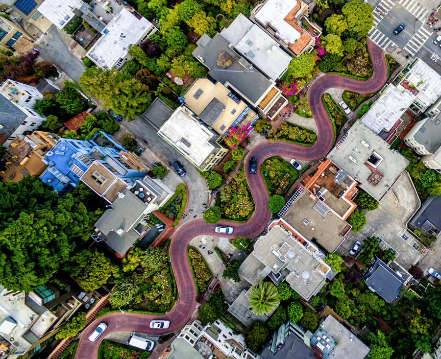 From the air, it's much easier to see how Lombard Street snakes through the streets of San Francisco. One of the most iconic landmarks of San Francisco—with its eight sharp turns is said to be the most crooked street in the world.  © Chris McCann / National Geographic Travel Photographer of the Year Contest