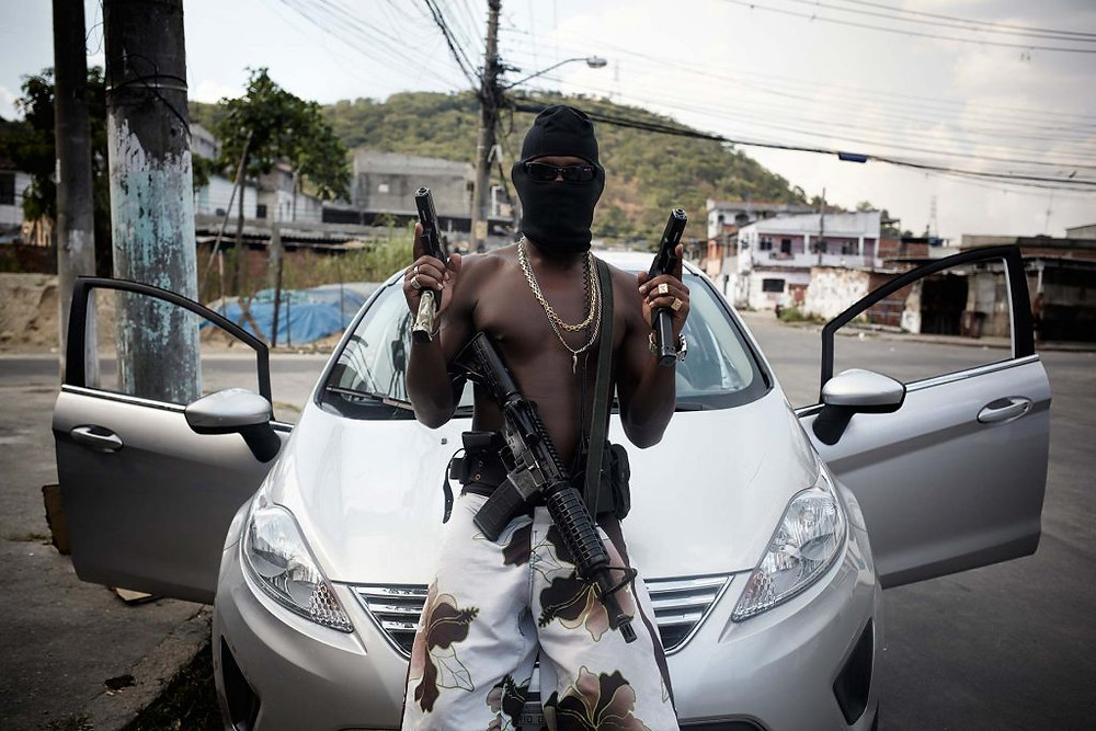 """RIO DE JANEIRO, BRAZIL - FEBRUARY 8: A gang member also known as """"Trafficante"""" poses with his weapons in Villa Allianca, one of the many non pacified favelas of Rio de Janeiro. February 8, 2014. (Photo by Sebastiano Tomada/Reportage by Getty Images)"""