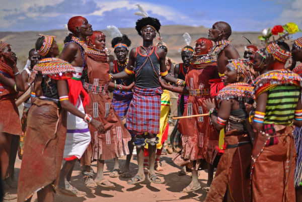 Members of the Rendile tribe and the Turkana tribe dance before total hybrid eclipse in Sibiloi national Park in Turkana on November 3, 2013. (Photo credit CARL DE SOUZA/AFP/Getty Images)
