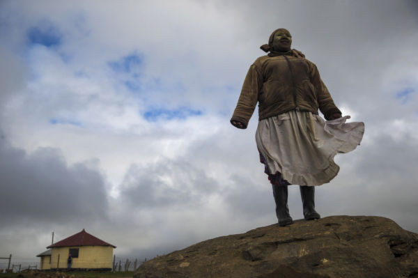 QUNU, SOUTH AFRICA - DECEMBER 12:  A Xhosa woman poses on a rock overlooking Qunu as preparations continue ahead of the funeral of former South African President Nelson Mandela on December 12, 2013 in Qunu, South Africa.