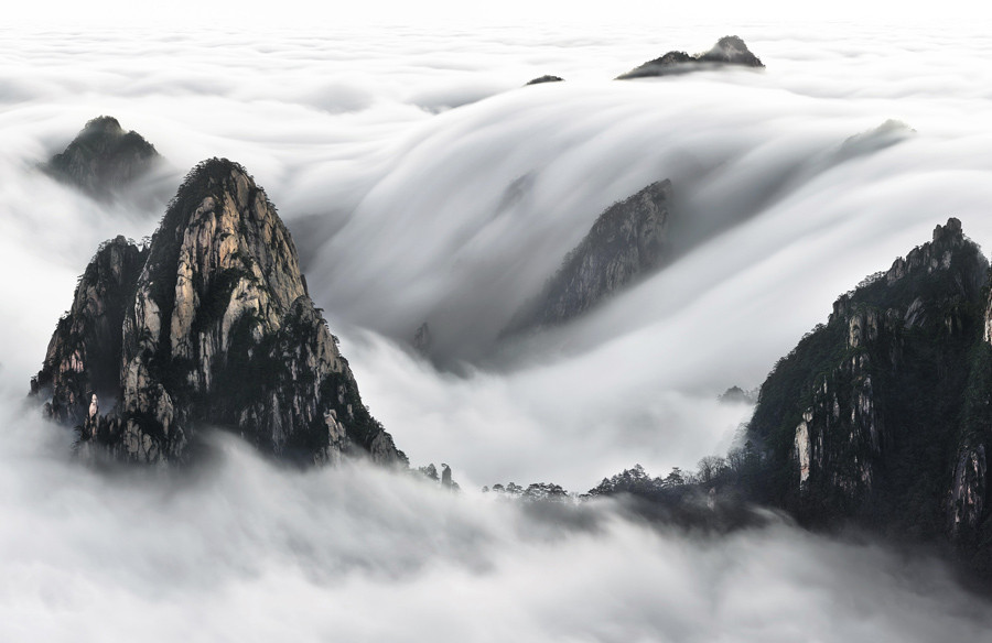 This image was captured very early in the morning after climbing Yellow Mountain at 3 a.m. and waiting for few hours in the cold and wind at -4 degrees.  © Thierry Bornier / National Geographic Travel Photographer of the Year Contest