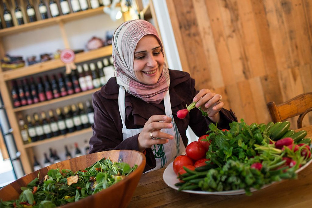 """Lebanon / Syrian Refugees / Rasha Mhemid, 31, from Homs, prepares fresh vegetables in Tawlet restaurant Beirut, Lebanon, on 26 February 2014. Rasha fled from Homs with her husband and 4 children in private taxi to Beirut. She thought they'd only be gone for five months – a temporary departure, an extended holiday, as she explained it to her children. But she has only recently accepted the reality of building new lives from scratch.  """"Now our neighborhood is closed,"""" she says. """"They can't get out and we can't even reach them by phone."""" She says she used to cry every day, but cooking has given her something to do – a way to keep her mind off the crisis, a passion to keep her looking ahead and not behind. """"Before the program, I had no friends. Now I have sisters. I still cry, but not as much."""""""