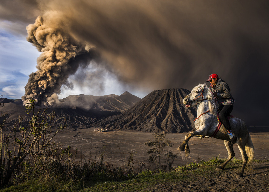 This picture was taken during Mt. Bromo eruption, the horse seems a little agitated due to the sound of the eruption.  © Reynold Dewantara / National Geographic Travel Photographer of the Year Contest