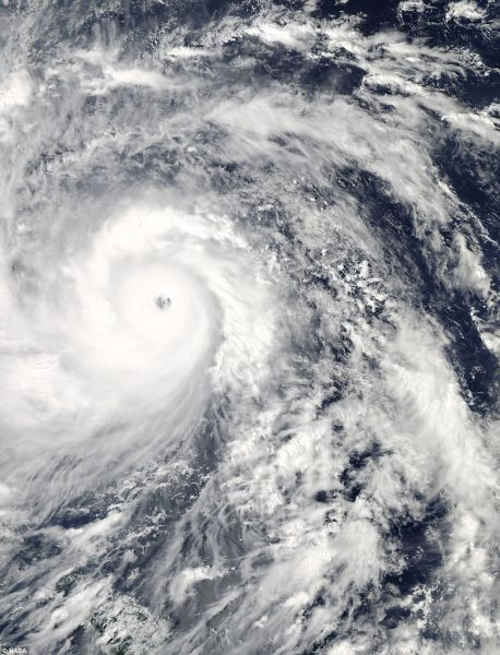 Scary but Beautiful: Supertyphoon Haiyan the day before it made landfall in the Philippines. The coast of the Philippines can be seen outlined on the far left of the image. Captured Nov 7 by NASA's Aqua satellite
