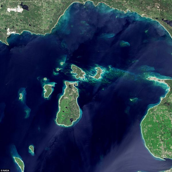 The world's most gorgeous great lake: A cluster of small images in the far northern reaches of Lake Michigan in a photo captured May 24 by the NASA/USGS Landsat 8 satellite.