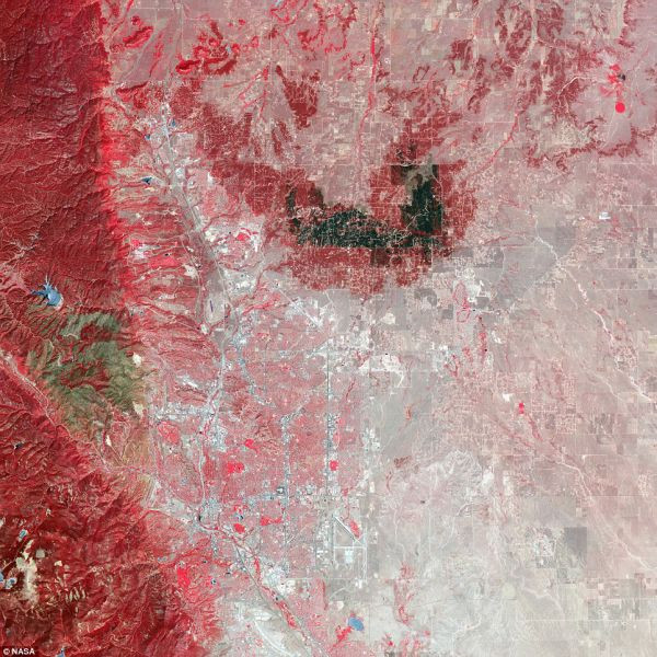 Running left to right through the center of this image is the scar from the EF-5 tornado that ran through Moore, Oklahoma on May 20, 2013 killing at least 24, injuring 377 and likely topping $2 billion in damages. Captured June 2 by NASA's Terra satellite
