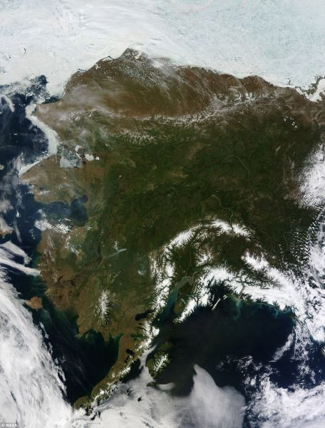 The great frozen land: Alaska is almost always mostly, or at least partially, covered with clouds, but this rare, cloudless moment was captured June 17 by NASA's Terra satellite.