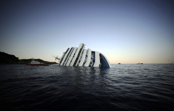 View of the Costa Concordia on January 14, 2012, after the cruise ship ran aground and keeled over off the Isola del Giglio. (Photo credit FILIPPO MONTEFORTE/AFP/Getty Images)