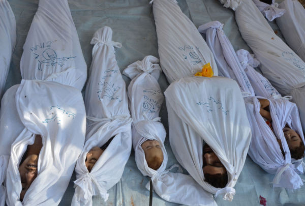 Bodies of people activists say were killed by nerve gas in the Ghouta region are seen in the Duma neighbourhood of Damascus August 21, 2013. REUTERS/Bassam Khabieh