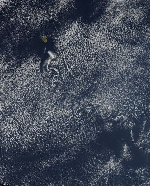 Nature's Art Canvas: Isla Socorro creates von Karman vortices in the clouds above the Pacific ocean May 22 in this image captured by NASA¿s Aqua satellite