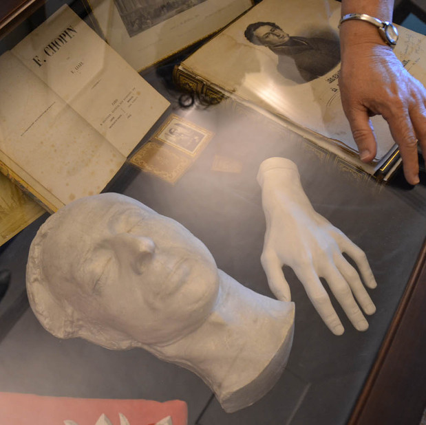 Bonnie's hand with a cast of Chopin's hand