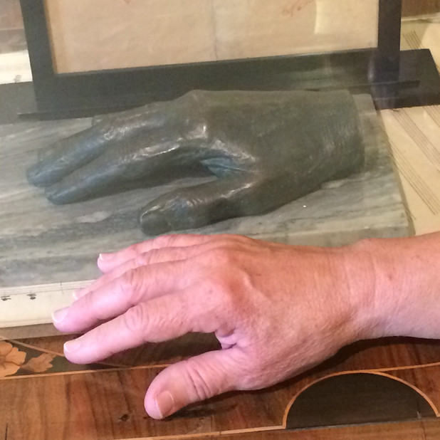 Bonnie's hand with a cast of Liszt's hand