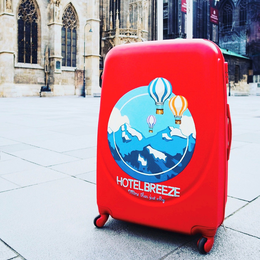 Hotelbreeze blog mascot, Oscar the red suitcase.