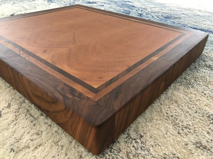 Bookmatched cherry with walnut frame