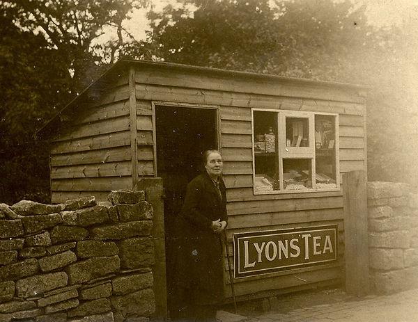 Shopkeeper-outside-her-confectionary-she