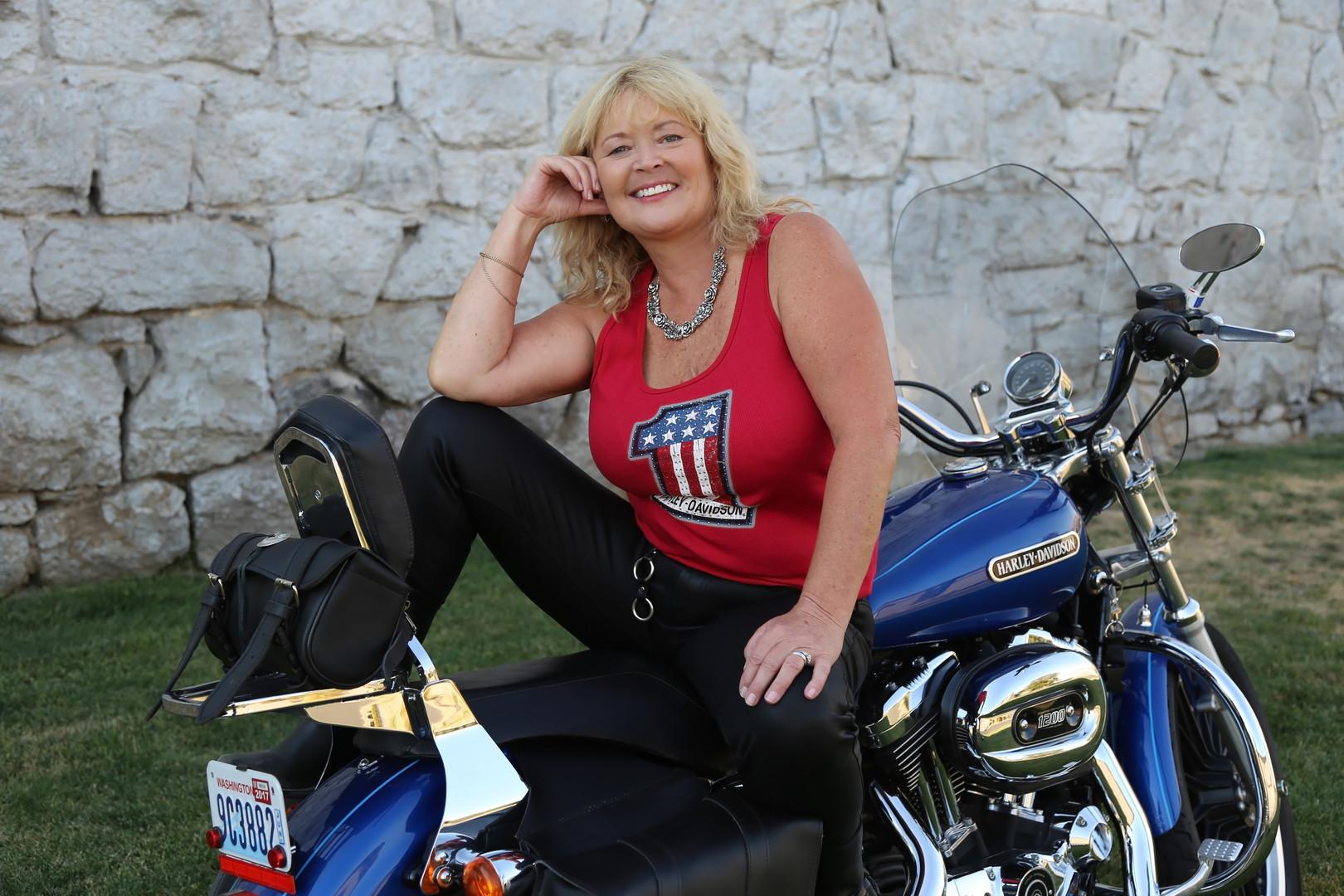 Blonde woman on motorcycle