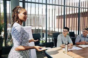 businesswoman-explaining-strategy-of-dev