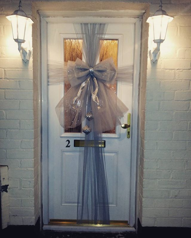 Silver sparkles double door bow ❄❄❄ £25 including embellishments and installation ❄❄❄ #doorbowsliver